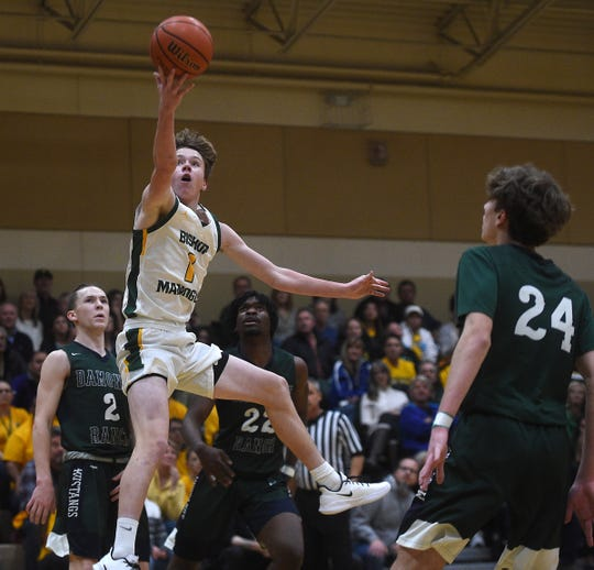 Bishop Manogue's Logan Howren drives to the basket while taking on Damonte Ranch during their basketball game in Reno on Jan. 31, 2020.