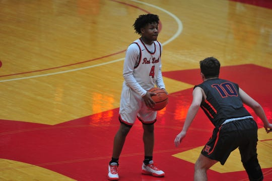 Richmond senior point guard Koream Jett scored a team-high 10 points in the Red Devils' fifth consecutive victory on Friday night, a 49-46 win over Class 4A No. 14 Harrison.