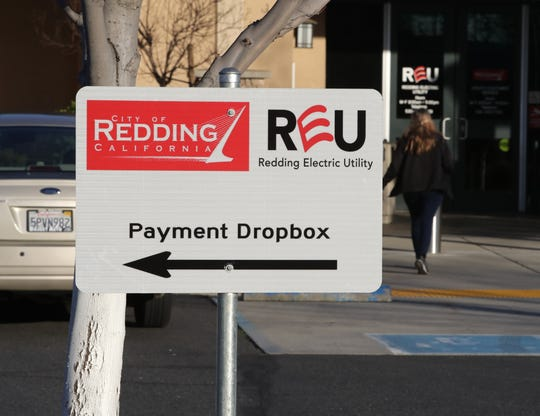 A sign points to the location of the payment dropbox outside the Redding Electric Utility office on Avtech Parkway off Airport Road.
