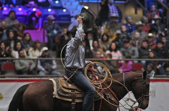 Ty Harris waves to the hometown crowd after competing in the tie down roping event during the second day of competition at the San Angelo Stock Show and Rodeo on Friday, Jan. 31, 2020.