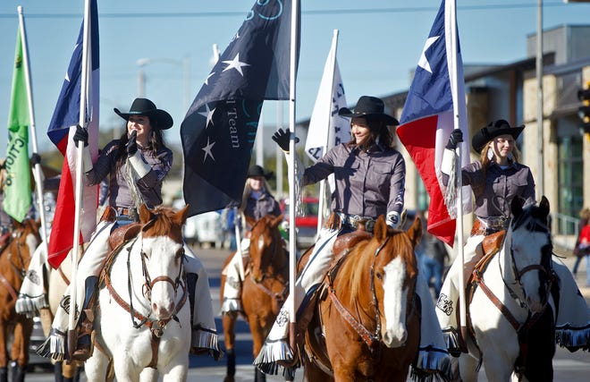 Participants parade through the streets of downtown during the San Angelo Stock Show and Rodeo parade Saturday, Feb. 1, 2020.