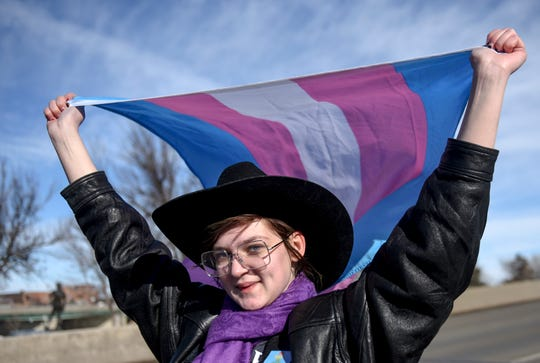 A supporter of transgender rights marches on Saturday, Feb. 1, 2020 in downtown Sioux Falls. The protest comes after South Dakota legislature introduced two bills targeting transgender youth.