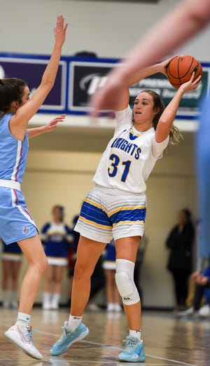 O'Gorman's Emma Ronsiek (31) looks to make a pass during the game against Lincoln on Friday, Jan. 31, 2020 at the O'Gorman High School.