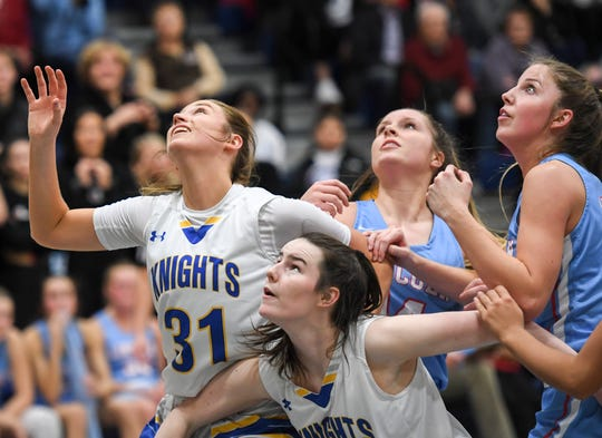 Lincoln and O'Gorman look to rebound the ball during a girls game on Friday, Jan. 31, 2020 at the O'Gorman High School.
