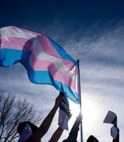 Supporters of transgender rights march on Saturday, Feb. 1, 2020 in downtown Sioux Falls. The protest comes after South Dakota legislature introduced two bills targeting transgender youth.