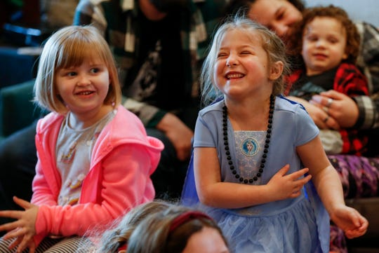 Edie Goeppinger, 5, left, and Nora Melvin-Head, 5, laugh as Lux has them recite a silly story during the Drag Queen Story Hour at the GLO Center on Saturday, Feb. 1, 2020.