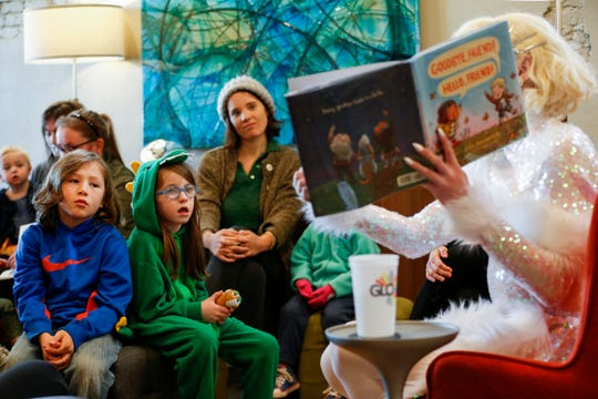 Xander Rogers, 7, left, and Penelope Woody, 7, listen as Lux reads them a story during the Drag Queen Story Hour at the GLO Center on Saturday, Feb. 1, 2020.