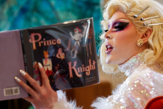 Lux reads from a book during the Drag Queen Story Hour at the GLO Center on Saturday, Feb. 1, 2020.