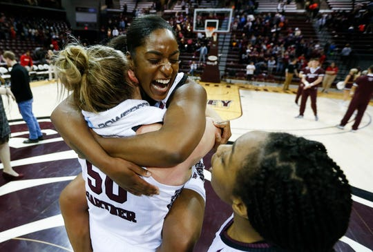 Missouri State Lady Bears guard Bri Ellis (24) is picked up by Missouri State Lady Bears center Emily Gartner (50) after the Lady Bears' 90-56 victory over the Bradley Braves at JQH Arena on Friday, Jan. 31, 2020.
