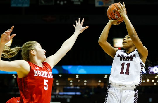 Missouri State Lady Bears guard Brice Calip (11) shoots a field goal over Bradley Braves forward Chelsea Brackmann (5) during a game at JQH Arena on Friday, Jan. 31, 2020.