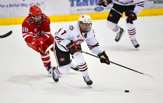 St. Cloud State's Nick Poehling skates against Miami's Monte Graham during the first period of the Friday, Jan. 31, 2020, game at the Herb Brooks National Hockey Center in St. Cloud.