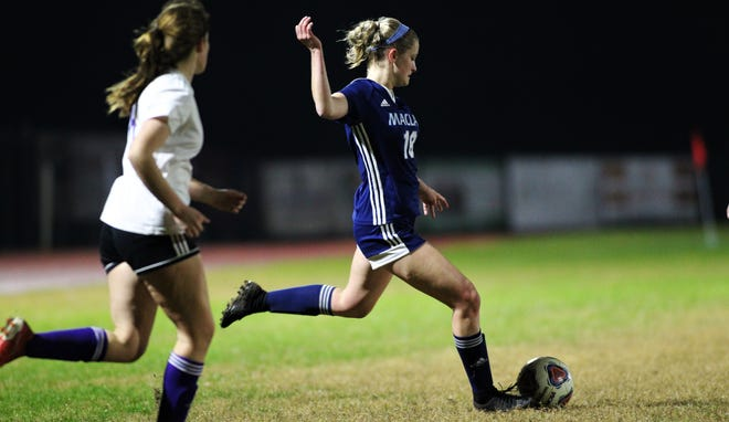 Maclay senior Avery Smith crosses a ball as Maclay's girls soccer team beat Port St. Joe 6-0 in the District 2-2A championship game on Jan. 31, 2020.