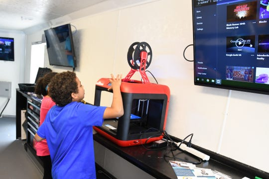 Students explore STEM technology in TCC's Digital Rail trailer at last fall's Tallahassee Science Fest.
