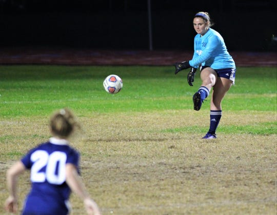 Maclay freshman keeper Emily Macri passes to a defender as Maclay's girls soccer team beat Port St. Joe 6-0 in the District 2-2A championship game on Jan. 31, 2020.