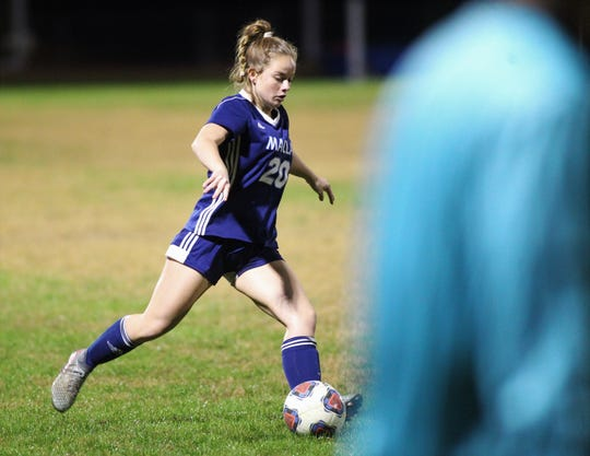 Maclay senior Lauren Dessi plays a pass as Maclay's girls soccer team beat Port St. Joe 6-0 in the District 2-2A championship game on Jan. 31, 2020.