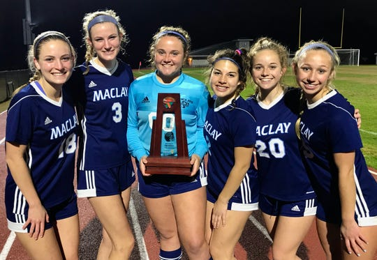 Maclay sisters Avery Smith and Kate Smith, Emily Macri and Nicole Macri, and Lauren Dessi and Katelyn Dessi celebrate after Maclay's girls soccer team beat Port St. Joe 6-0 in the District 2-2A championship game on Jan. 31, 2020.