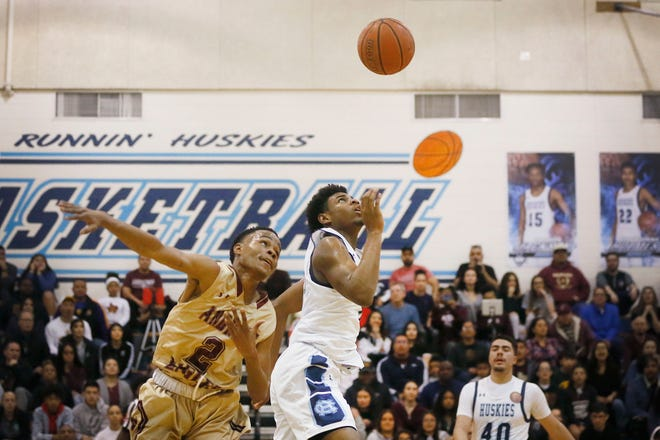 Chapin's Kj Lewis and Andress' Isaiah Pace during the game in a key District 1-5A boys basketball showdown Friday, Jan. 31, at Chapin High School in El Paso. Andress won 68-64 against Chapin.