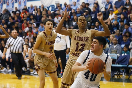 Chapin's Manuel Flores goes against Andress defense during the game in a key District 1-5A boys basketball showdown Friday, Jan. 31, at Chapin High School in El Paso. Andress won 68-64 against Chapin.