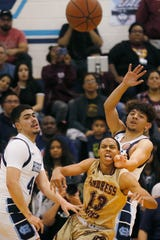 Andress' Devonte Owens goes against Chapin defense during the game in a key District 1-5A boys basketball showdown Friday, Jan. 31, at Chapin High School in El Paso. Andress won 68-64 against Chapin.
