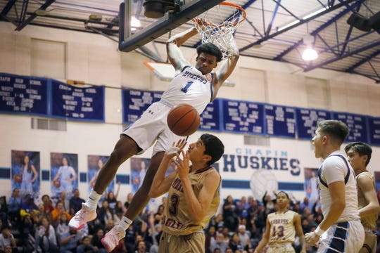 Chapin's Kj Lewis dunks against Andress during the game in a key District 1-5A boys basketball showdown Friday, Jan. 31, at Chapin High School in El Paso. Andress won 68-64 against Chapin.