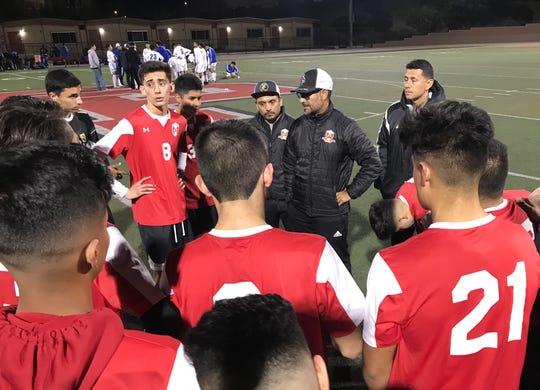 Santa Paula boys soccer coach Manny Elizarraraz meets with his team after the Cardinals' 3-1 win over visiting Fillmore on Friday night at Jones Field.
