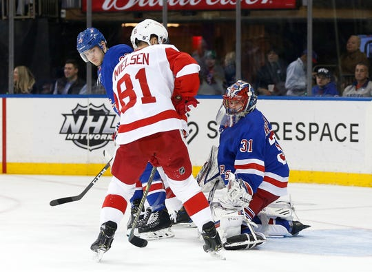 Jan 31, 2020; New York, New York, USA; New York Rangers goaltender Igor Shesterkin (31) defends the goal against Detroit Red Wings center Frans Nielsen (81) during the first period at Madison Square Garden. Mandatory Credit: Andy Marlin-USA TODAY Sports