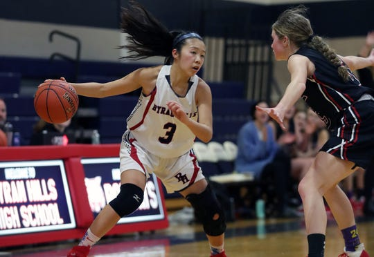 Byram Hills' Jen Mui (3) tries to get around Rye's Mara Ball (5)  during girls basketball action at Byram Hills High School in Armonk  Jan. 31, 2020. Rye won the game 62-54.