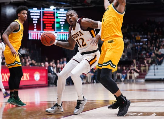 Iona's Tajuan Agee attempts to drive inside during Iona's 87-64 loss to Siena on Friday, Jan. 31, 2020.