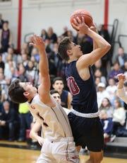 Byram Hills' Jon Trongone goes up for a shot during the Rye vs. Byram Hills boys basketball game at Rye High School, Jan. 31, 2020.