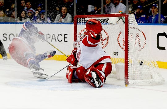Jan 31, 2020; New York, New York, USA; New York Rangers right wing Pavel Buchnevich (89) scores a goal against Detroit Red Wings goaltender Jimmy Howard (35) during the second period at Madison Square Garden. Mandatory Credit: Andy Marlin-USA TODAY Sports