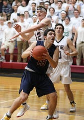 Byram Hills Benji Hammond tries to get off a shot in front of Rye's James Mackie during the Rye vs. Byram Hills boys basketball game at Rye High School, Jan. 31, 2020.