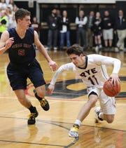Rye's Quinn Kelly moves the ball in front of Byram Hills' Sam Goldman during the Rye vs. Byram Hills boys basketball game at Rye High School, Jan. 31, 2020.