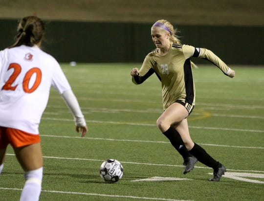 Rider's Mindy Shoffit dribbles in the match against McKinney North Friday, Jan. 31, 2020, at Memorial Stadium.