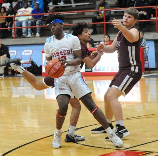 Hirschi's Jahiem Quarles comes down with a loose ball in front of Vernon's Ismael Ortega and Kolton Freeman (right) in District 6-4A action at Hirschi Fieldhouse on Friday, Jan. 31, 2020.
