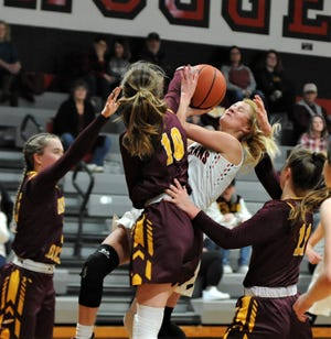 Rosecrans' Kailey Zemba is hounded by the Berne Union defense, including Sophia Kline (10) and Baylee Mirgon (11) in Saturday's game. The Rockets won 44-32.