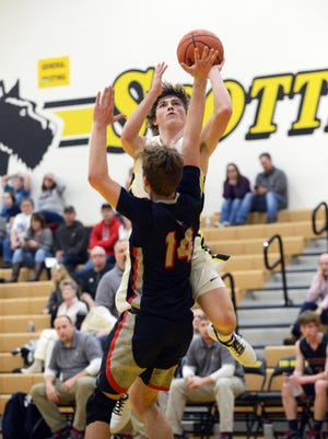 Tri-Valley's Skye Bryan goes up for a shot over Morgan's Carver Myers on Friday night in Dresden. Bryan scored a team-high 18 points as the Scotties won, 64-57.