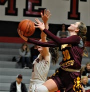 Berne Union's Bella Kline lays the ball up against a Rosecrans defender in Saturday's game. The Rockets won 44-32.