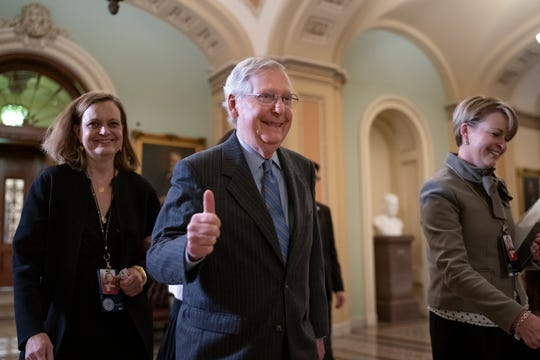 Senate Majority Leader Mitch McConnell, R-Ky., gives a thumbs-up as he leaves the chamber after Republicans defeated Democratic amendment to subpoena key witnesses in the impeachment trial of President Donald Trump on Jan. 31.