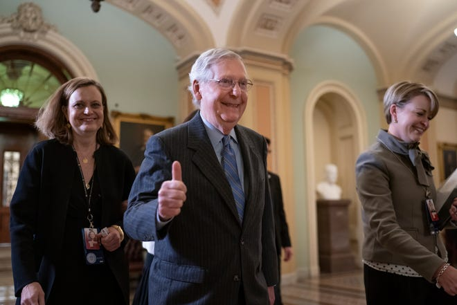 Senate Majority Leader Mitch McConnell, R-Ky., gives a thumbs-up as he leaves the chamber after Republicans defeated Democratic amendment to subpoena key witnesses in the impeachment trial of President Donald Trump on Friday.
