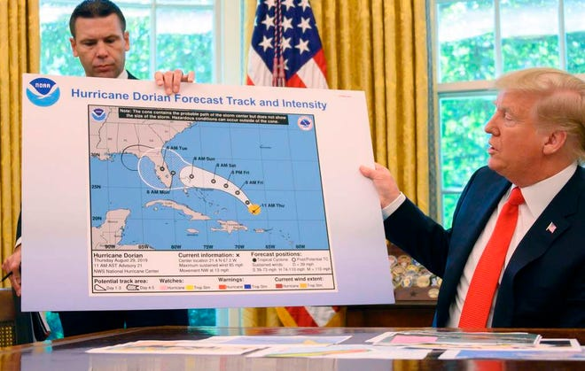 In this file photo taken on September 4, 2019,  President Donald Trump and Acting US Secretary of Homeland Security Kevin McAleenan update the media on Hurricane Dorian preparedness from the Oval Office at the White House in Washington, DC.