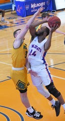 Louisiana College's KJ Bilbo (24) muscles his way forr two points against Belhaven University Saturday, Feb. 1, 2020. LC won 85-66.