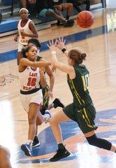 Louisiana College's Kayla Kinney (10) passes the ball against Belhaven University Saturday, Feb. 1, 2020. Belhaven won 94-78.