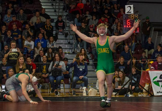 Brick Memorial's Joe Colon celebrates after he defeated Colts Neck's Luka Rada 9-6 in the 182-pound championship bout of the Shore Conference Tournament.
