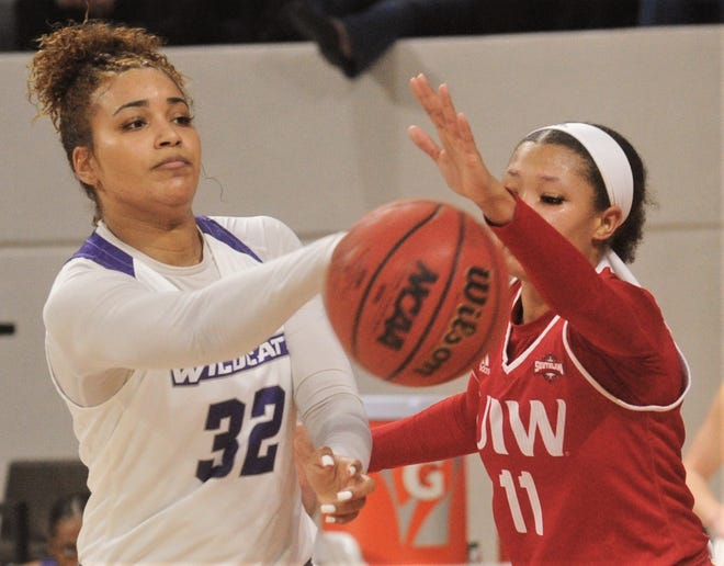 ACU's Makayla Mabry, left, passes the ball around Incarnate Word's Imani Robinson in the second half. The Cardinals beat ACU 71-70 in the Southland Conference game Saturday, Feb. 1, 2020, at Moody Coliseum.