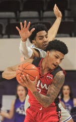 Incarnate Word's Keaston Willis pulls down a loose ball while ACU's Coryon Mason defends in the second half. ACU beat the Cardinals 72-58 in the Southland Conference game Saturday, Feb. 1, 2020, at Moody Coliseum.