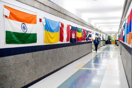 Flags from various countries line the hallway at Johnston Elementary January 24, 2020.