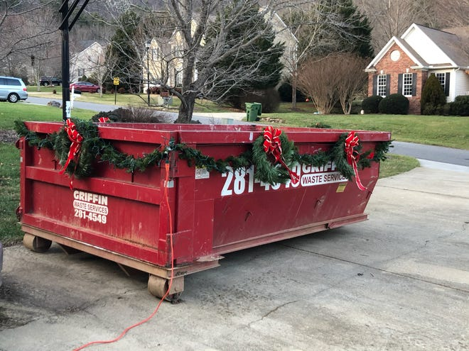 When an unexpected remodel happens at Christmastime, a decorated dumpster improves the situation a bit.