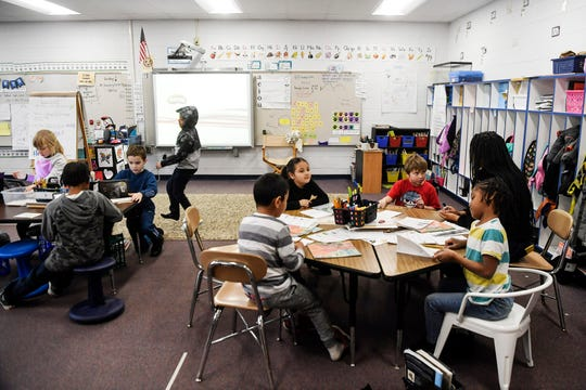 Johnston Elementary first-graders work on assignments in class January 24, 2020.