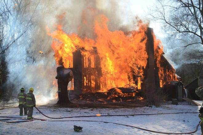 Firefighters let a house on West Michigan Avenue burn during a training exercise.