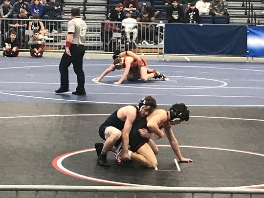 Tioga's Brady Worthing tries to control Mount Sinai's Mike O'Brien from the top position in the 145-pound match in Saturday's NYSPHSAA Dual Meet Tournament at Onondaga Community College's SRC Arena. Worthing won the match, 3-1.